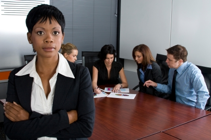 Multi-racial business team sitting around an office boardroom